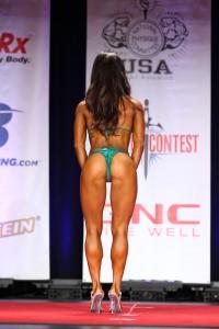 ting wang bikini competition on stage back pose