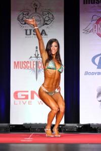 ting wang bikini competition on stage end pose