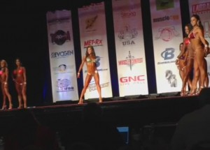 ting wang bikini competition on stage pose routine