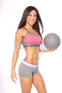 fitness model ting wang (tingfit) holding medicine ball