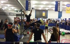 muscle up to handstand push-up on a human flag