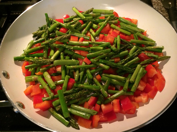 saute chopped bell peppers and asparagus