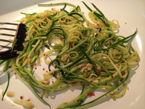 Softened zoodles with crushed red chili pepper
