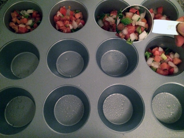 add 1/4 cup of pico de gallo in each muffin cup