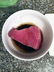 slather raw ahi tuna steak in sesame oil marinade