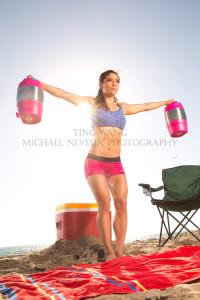 fitness-model-ting-wang-beach-water-jug-lateral-raise